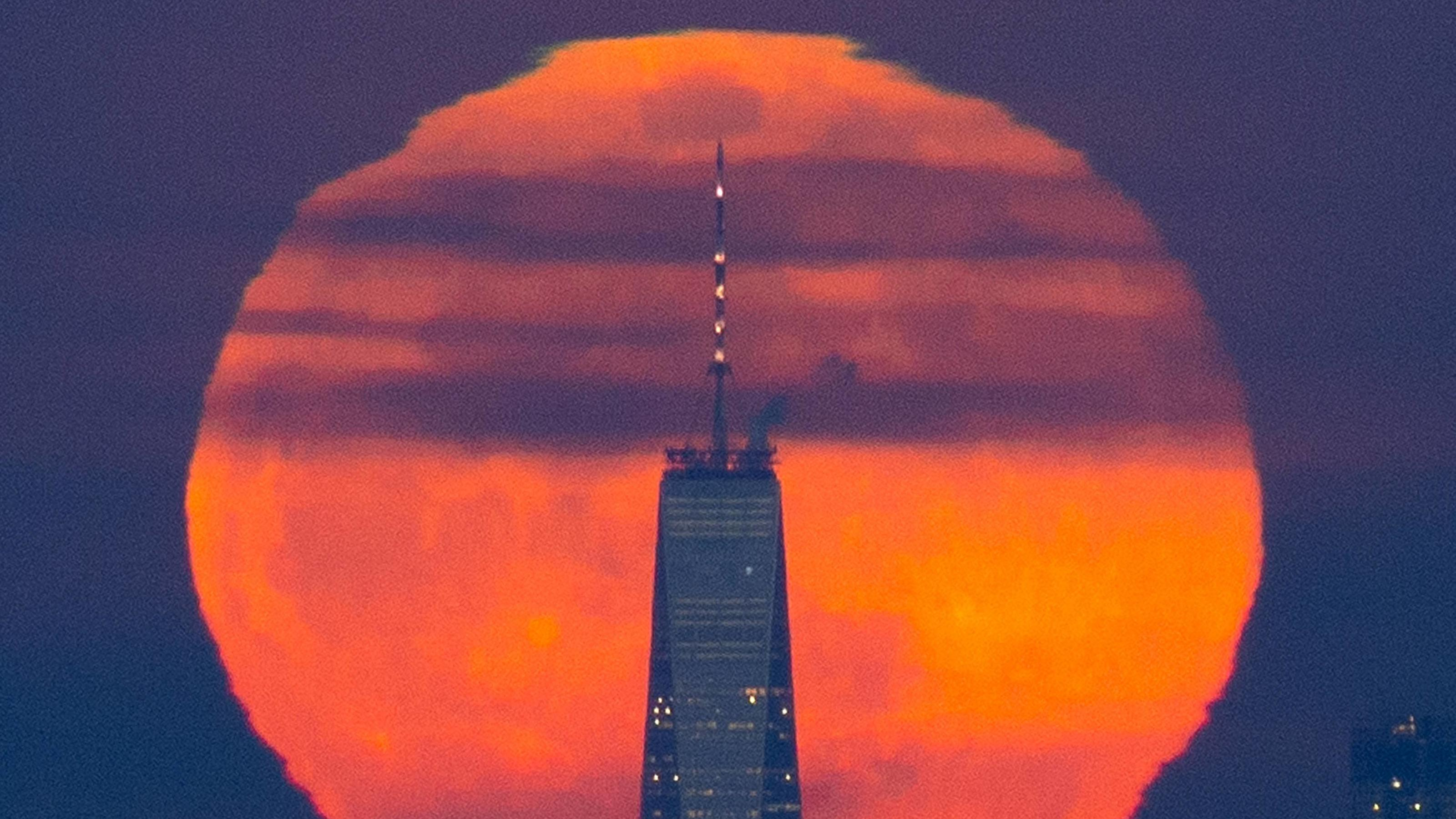 A Super Snow Moon rises behind One World Trade Center and the Manhattan skyline shorty after sunset on February 19, 2019 in New York City. The super snow moon is the second of three supermoon events in the first three months of the year -- a packed l