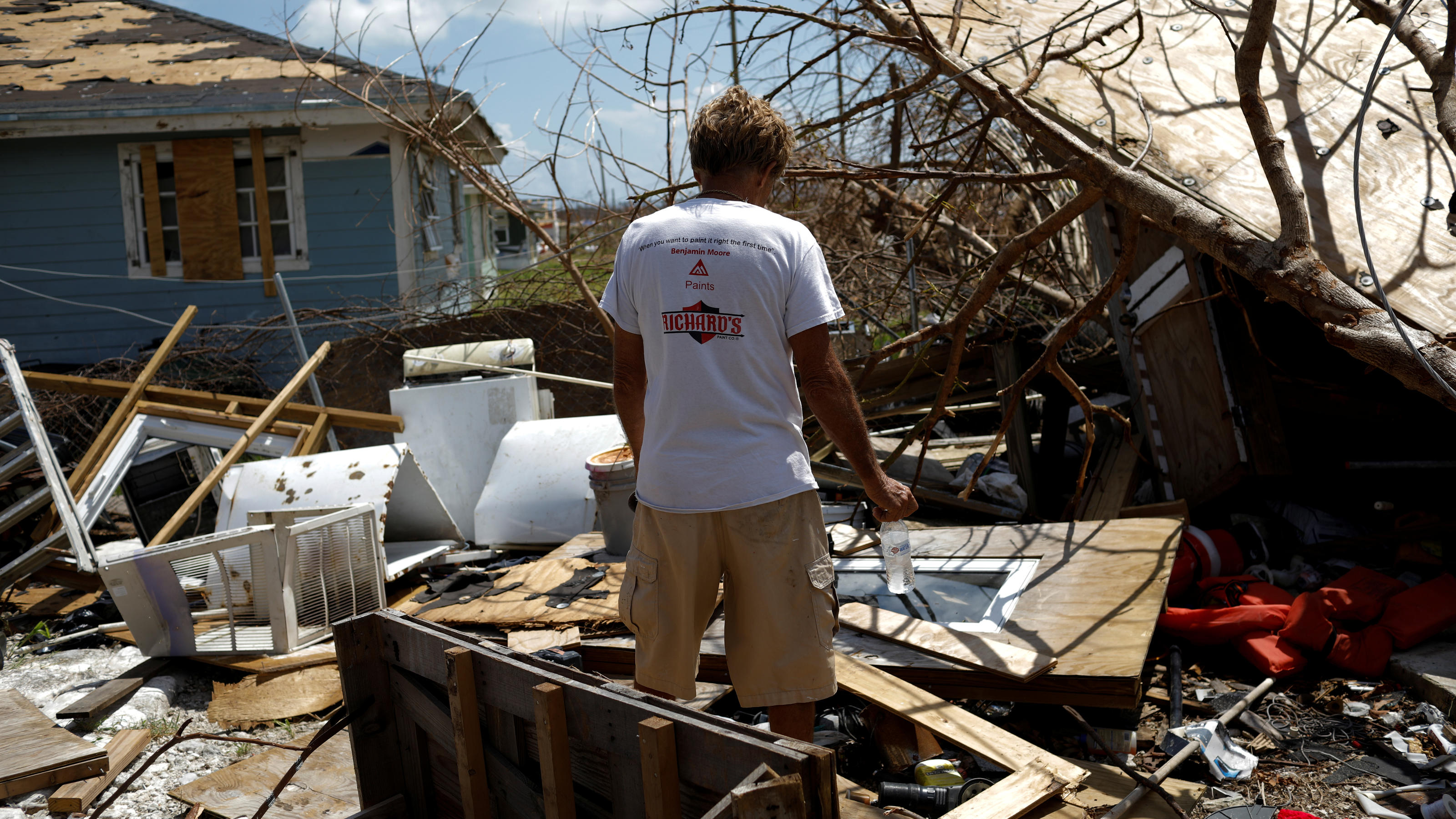 A man looks the devastated cabin at the back yard of his house after Hurricane Dorian hit the Abaco Islands in Spring City, Bahamas, September 11, 2019. REUTERS/Marco Bello