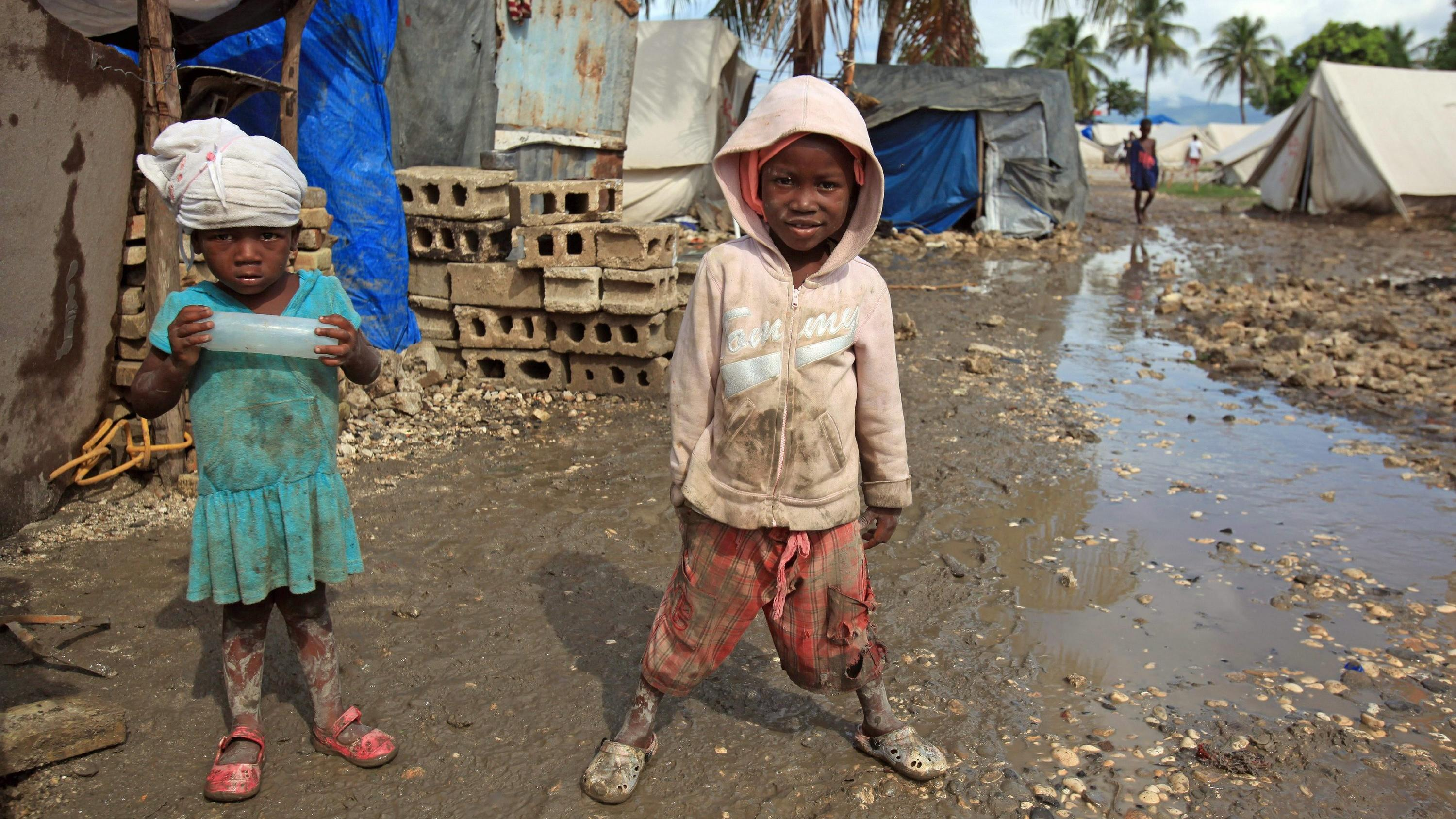 Two girls are seen at a refugee camp in Cite Soleil, located in Port-au-Prince, Haiti, 06 November 2010. Hurricane Tomas hit the country on 05 November, leaving five people dead, two missing and six injured, according to reports. EPA/ORLANDO BARRIA