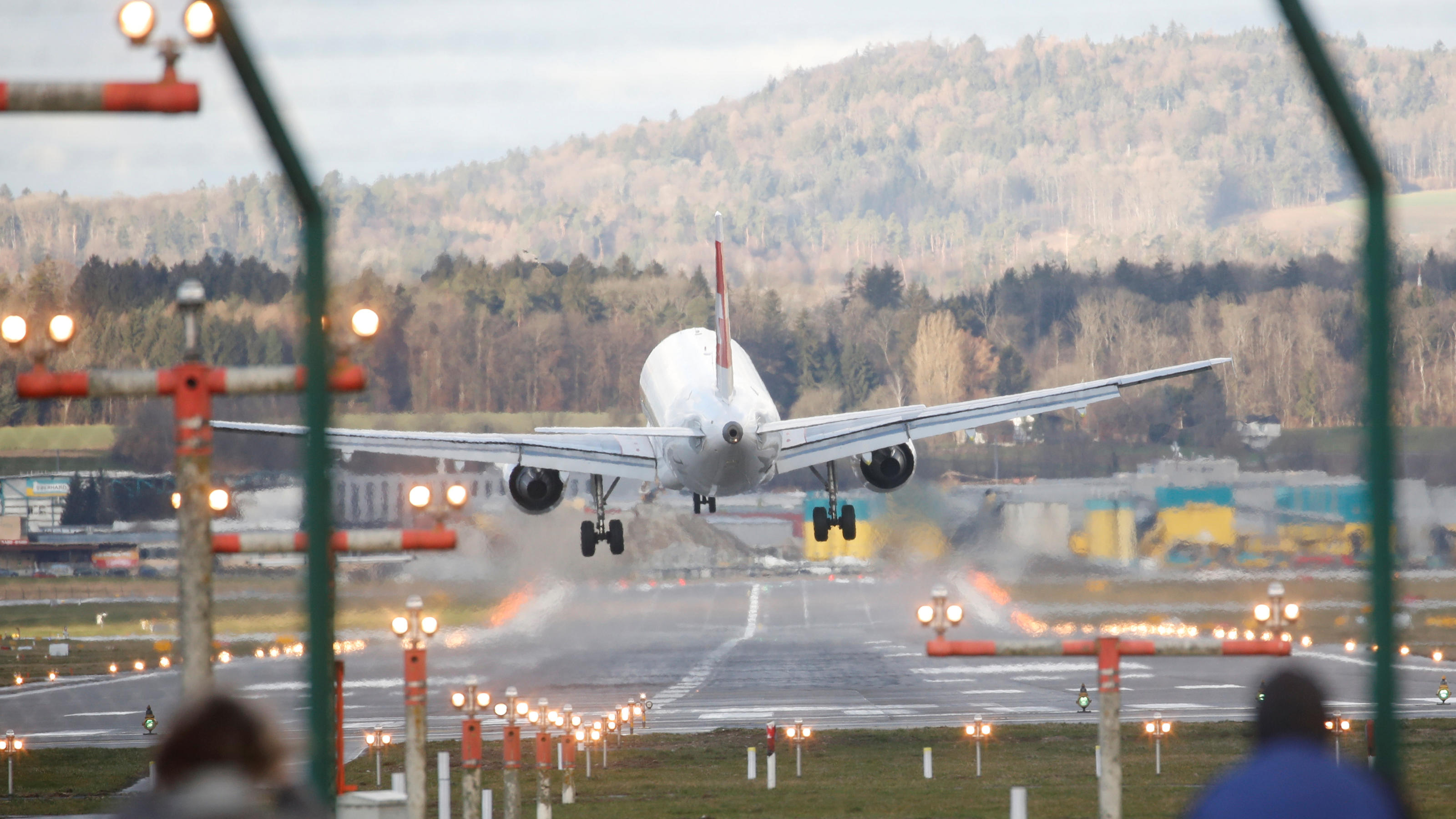 A plane of Swiss Airlines makes a go-around after trying to land during storm