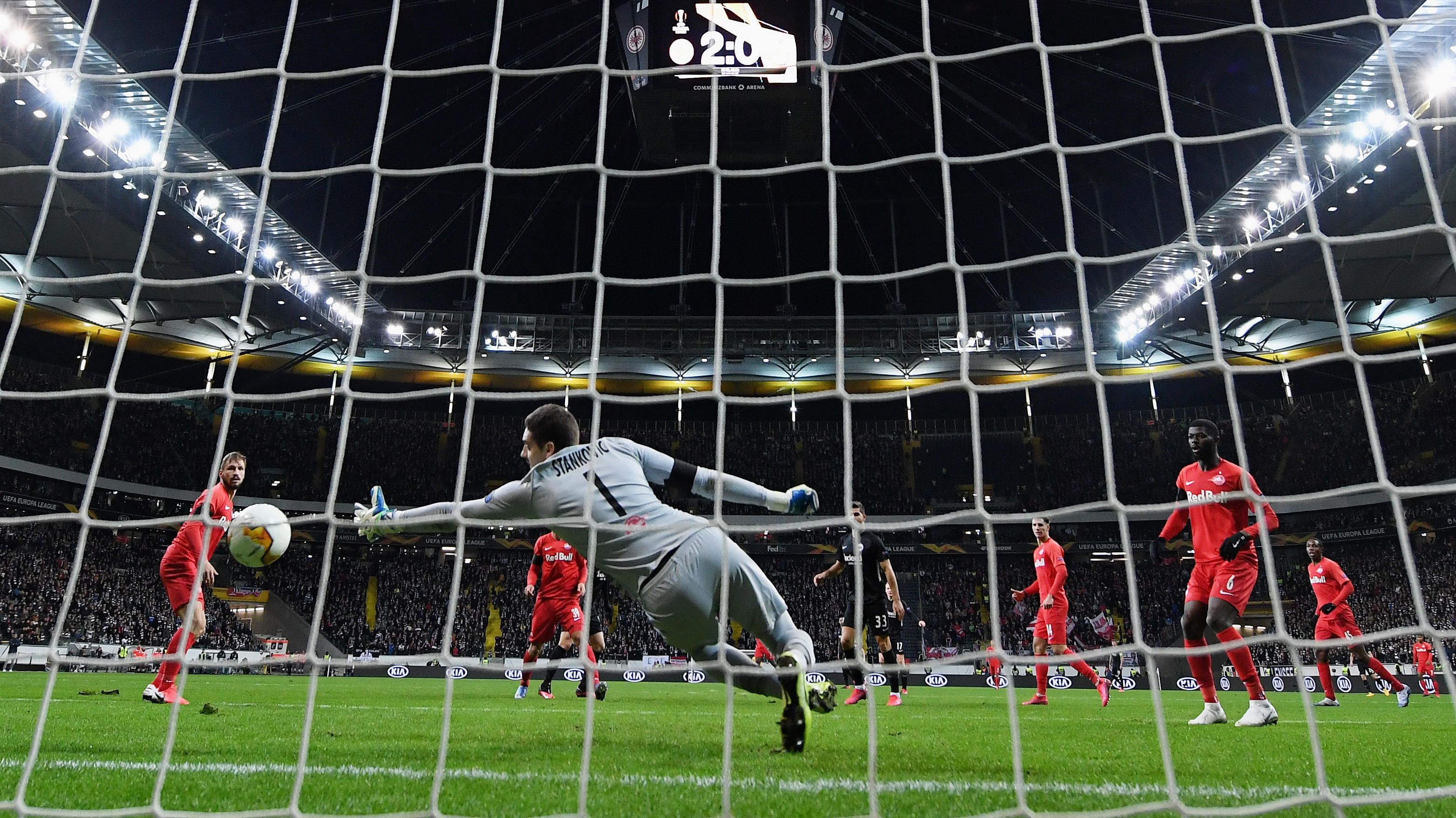 FRANKFURT AM MAIN, GERMANY - FEBRUARY 20: Daichi Kamada of Frankfurt scores his team's third goal during the UEFA Europa League round of 32 first leg match between Eintracht Frankfurt and FC Red Bull Salzburg at Commerzbank Arena on February 20, 2020