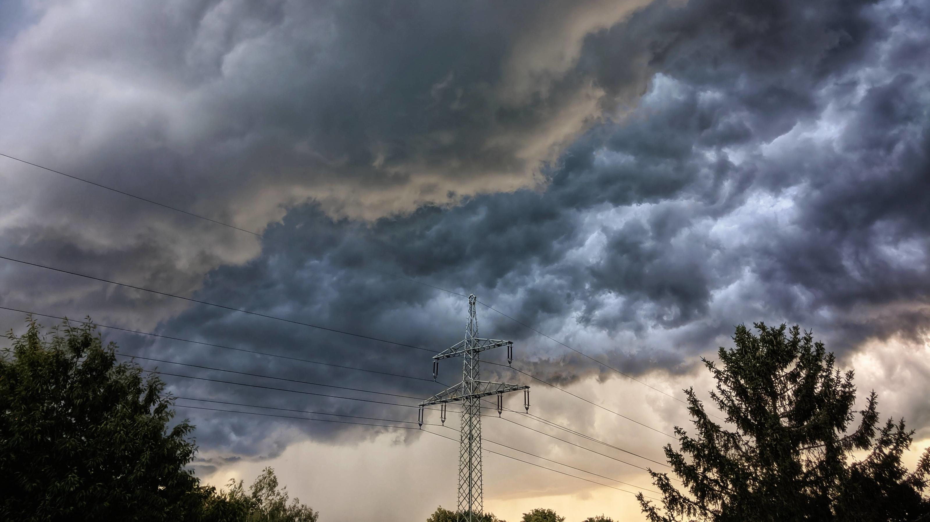 July 1, 2020, Munich, Bavaria, Germany: Dark, ominous storm clouds hover over Munich bringing thunder, lighting, and rain behind. Munich Germany - ZUMAb160 20200701_zbp_b160_001 Copyright: xSachellexBabbarx
