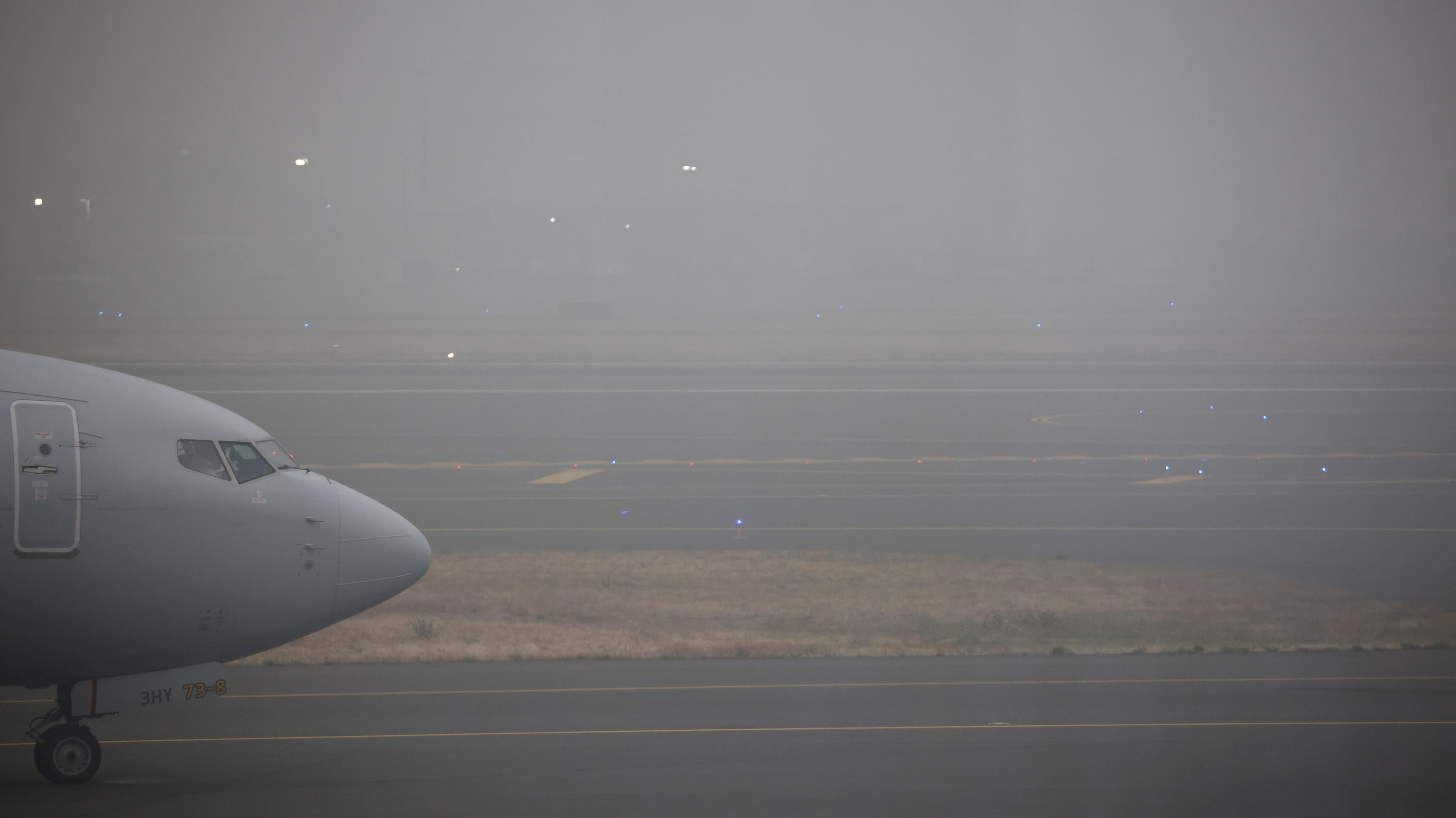 A commercial aircraft is seen as smoke from wildfires covers an area at the Portland International Airport, in Portland, Oregon, U.S., September 12, 2020. REUTERS/Carlos Barria