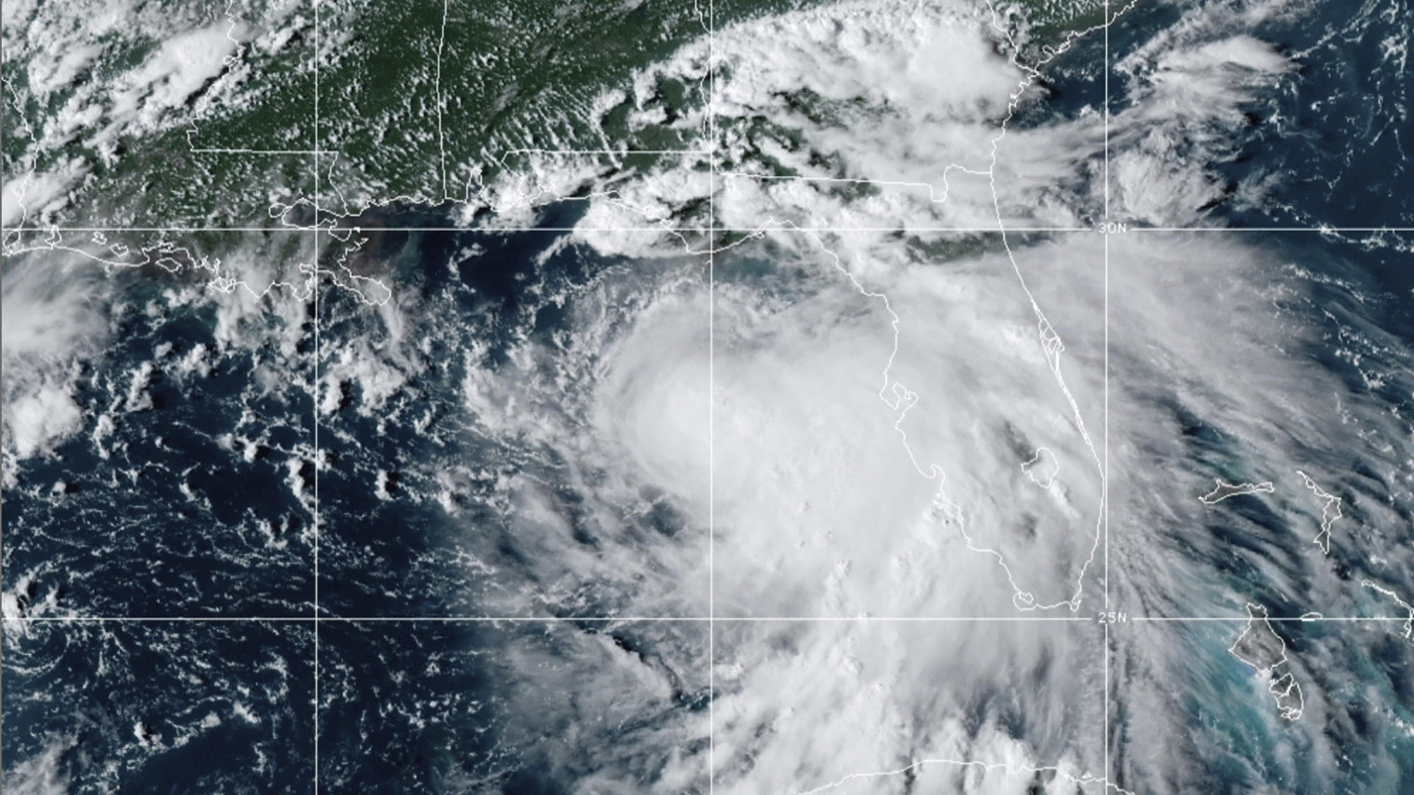 This satellite photo provided by the National Oceanic and Atmospheric Administration shows Tropical Storm Sally, Sunday, Sept. 13, 2020, at 2050 GMT. Sally churned northward on Sunday, poised to turn into a hurricane and send a life-threatening storm
