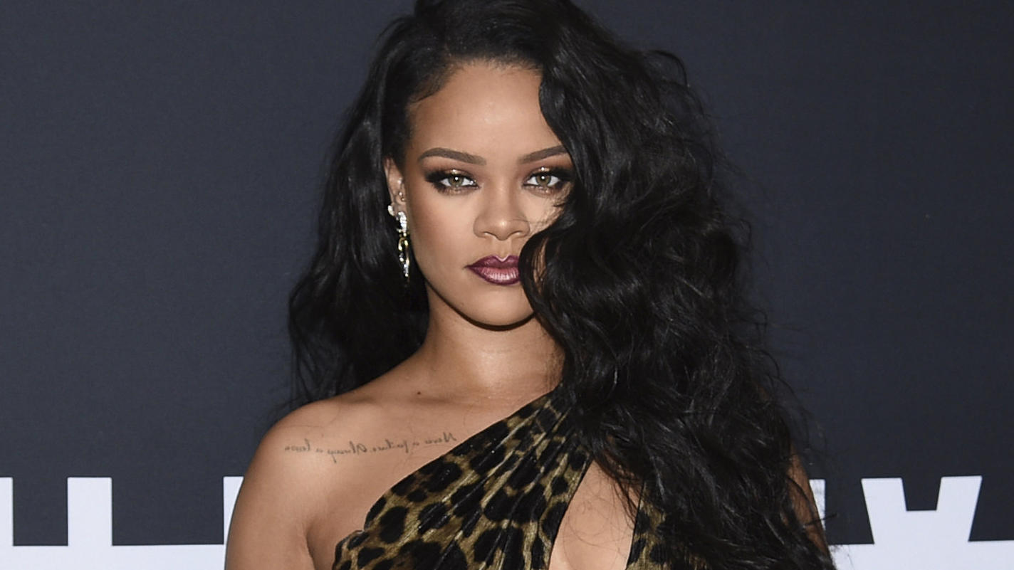 FILE - Singer and fashion designer Rihanna attends the
