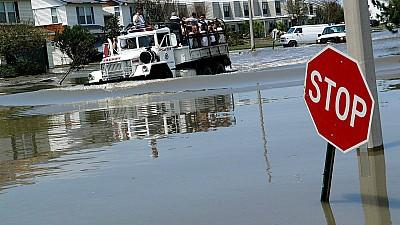 A group of people are rescued Tuesday, 30 August 2005, from the flood waters brought on by Hurricane Katrina in Slidell, Louisiana, some 25 miles (40 kilometers) from New Orleans. Hurricane Katrina made landfall on the Gulf Coast of the United States