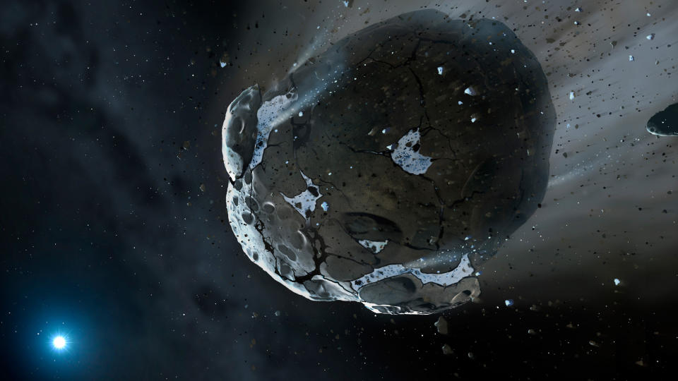 This is an artist's impression of a rocky and water-rich asteroid being torn apart by the strong gravity of the white dwarf star GD 61. Similar objects in our solar system likely delivered the bulk of water on Earth and represent the building blocks