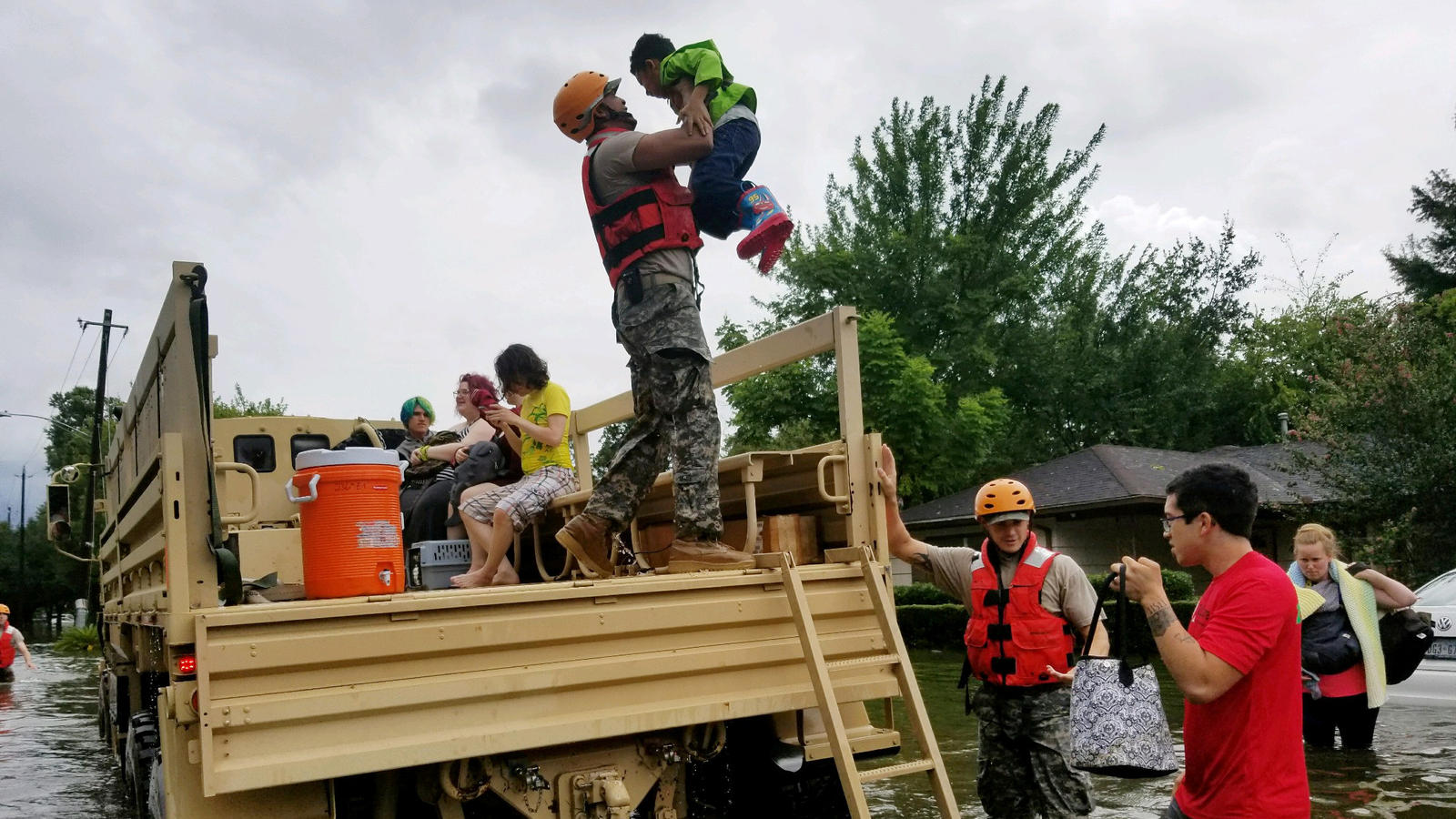 Texas National Guard soldiers aid residents in heavily flooded areas from the storms of Hurricane Harvey in Houston, Texas, U.S., August 27, 2017       Lt. Zachary West, 100th MPAD/Texas Military Department/Handout via REUTERS   ATTENTION EDITORS - T