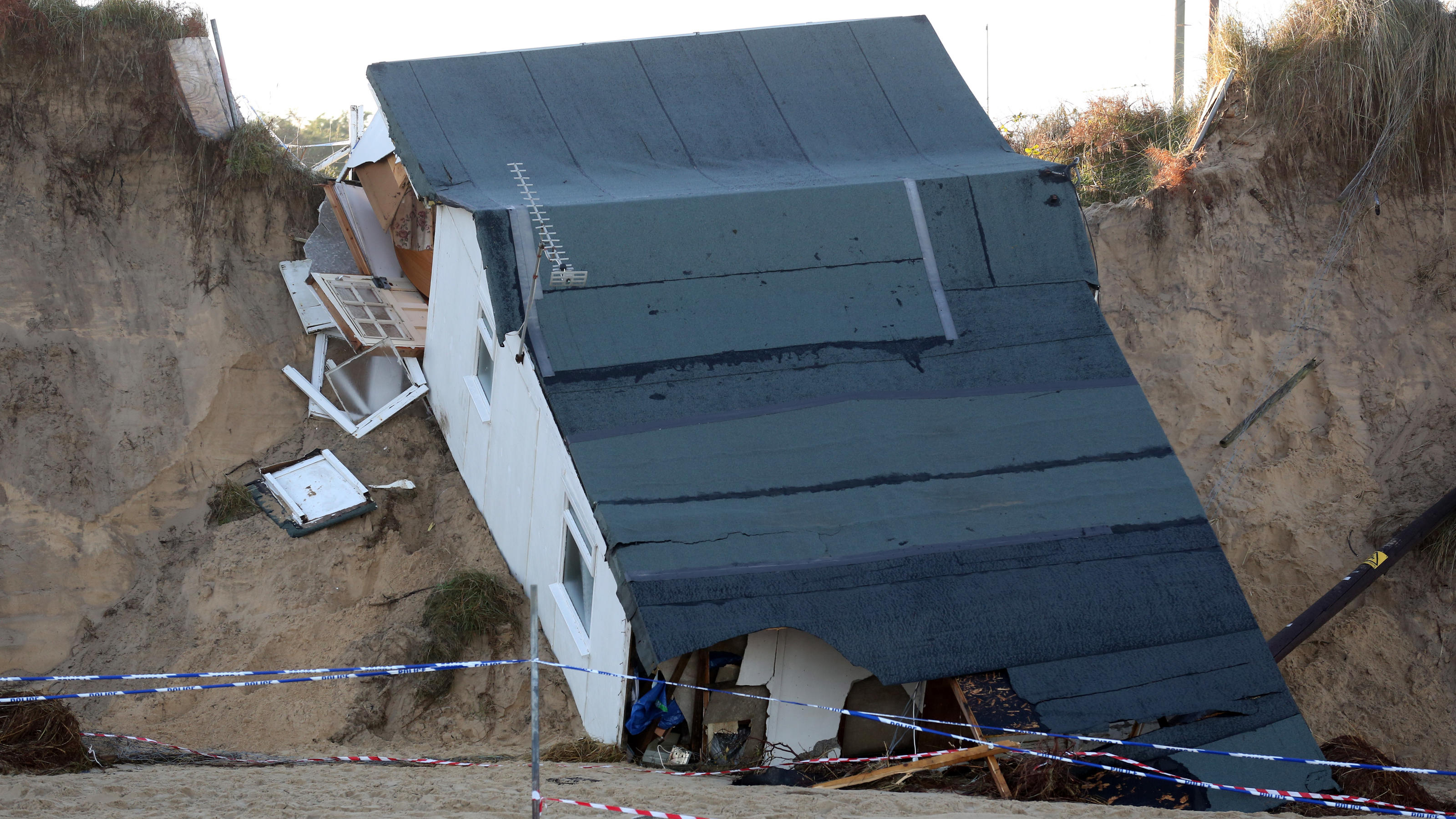 Tidal surge devastation. General view of a house after it's collapse following a tidal surge along the cliff edge on Hemsby beach in Norfolk last week. Picture date: Wednesday December 11th, 2013. Photo credit should read: Chris Radburn/PA Wire URN:1